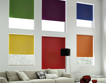 Multicoloured roller blinds in a white living room
