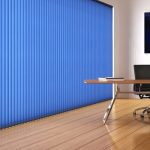 Bright blue vertical blinds in a office space