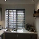 Grey kitchen venetian blinds in a neutral kitchen
