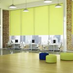 Bright lime green roller blinds in a big office space