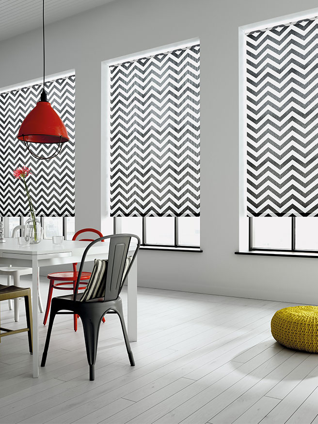Black and white aztec printed roller blinds in a white kitchen area