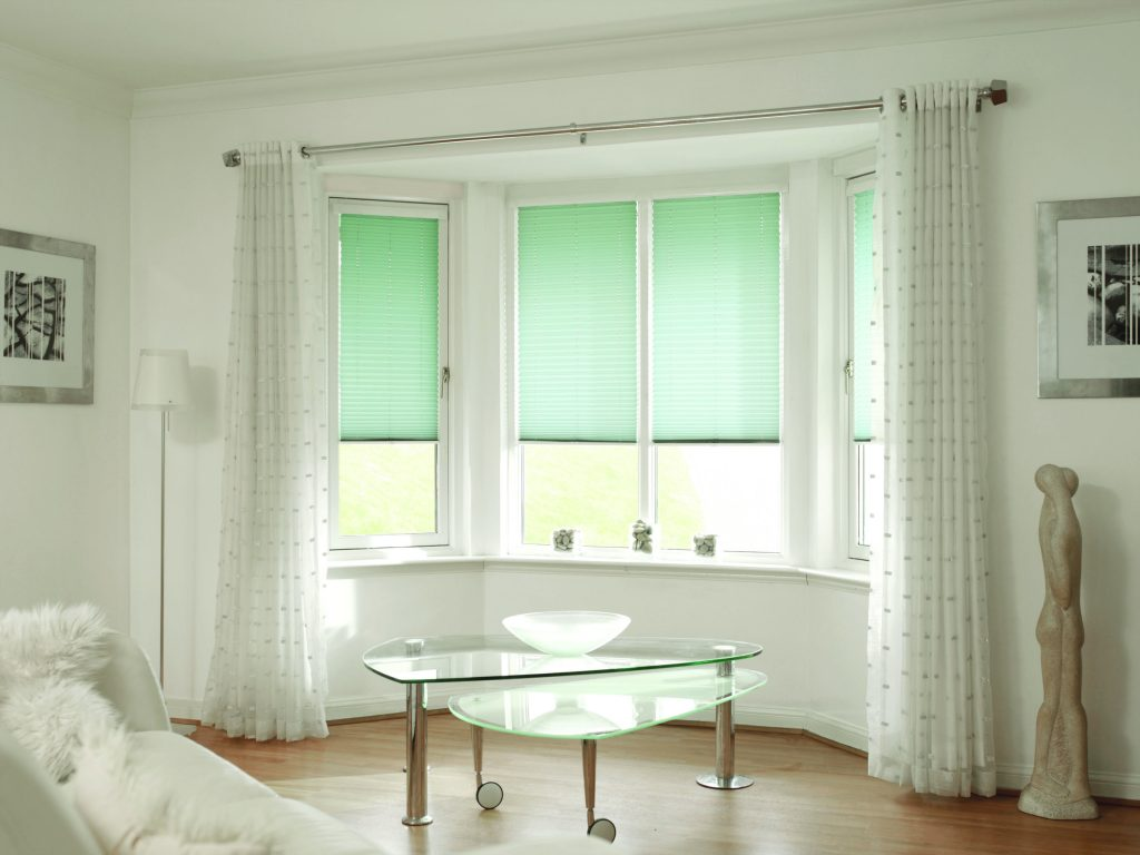 Lime green venetian blinds for bay window in living room