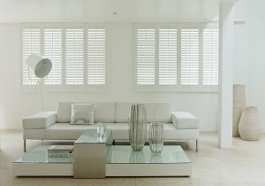White shutter blinds in an all white living area