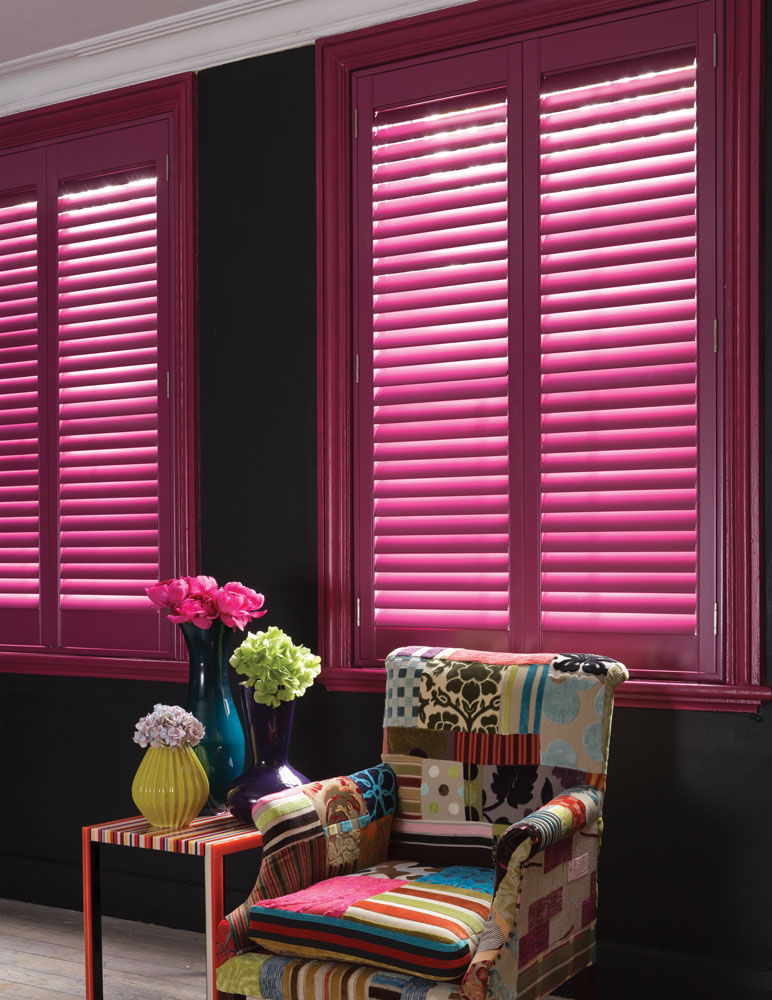 Pink shutter feature image with multi coloured chair in social area
