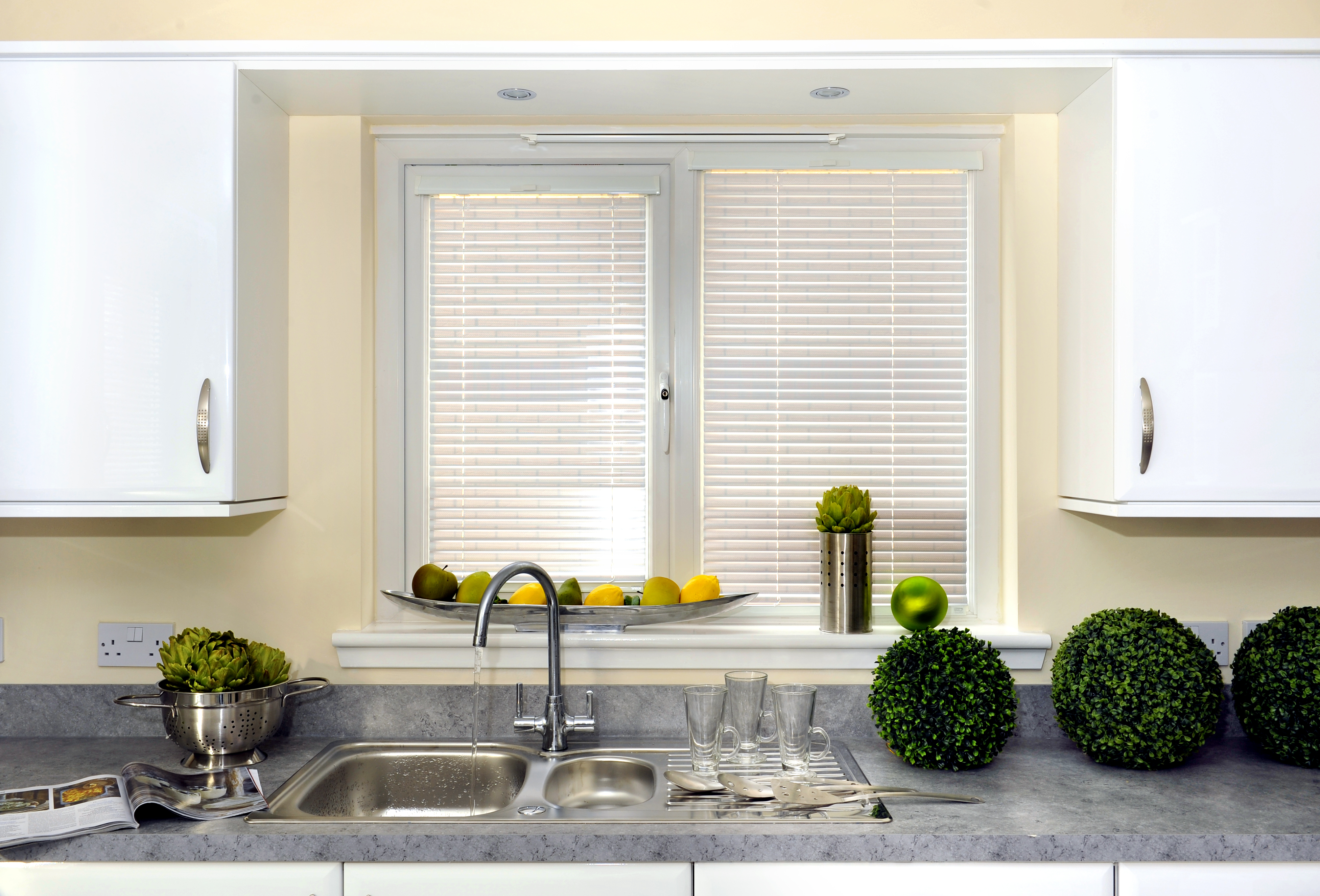 Window blinds Coventry. White venetian blinds by kitchen sink.