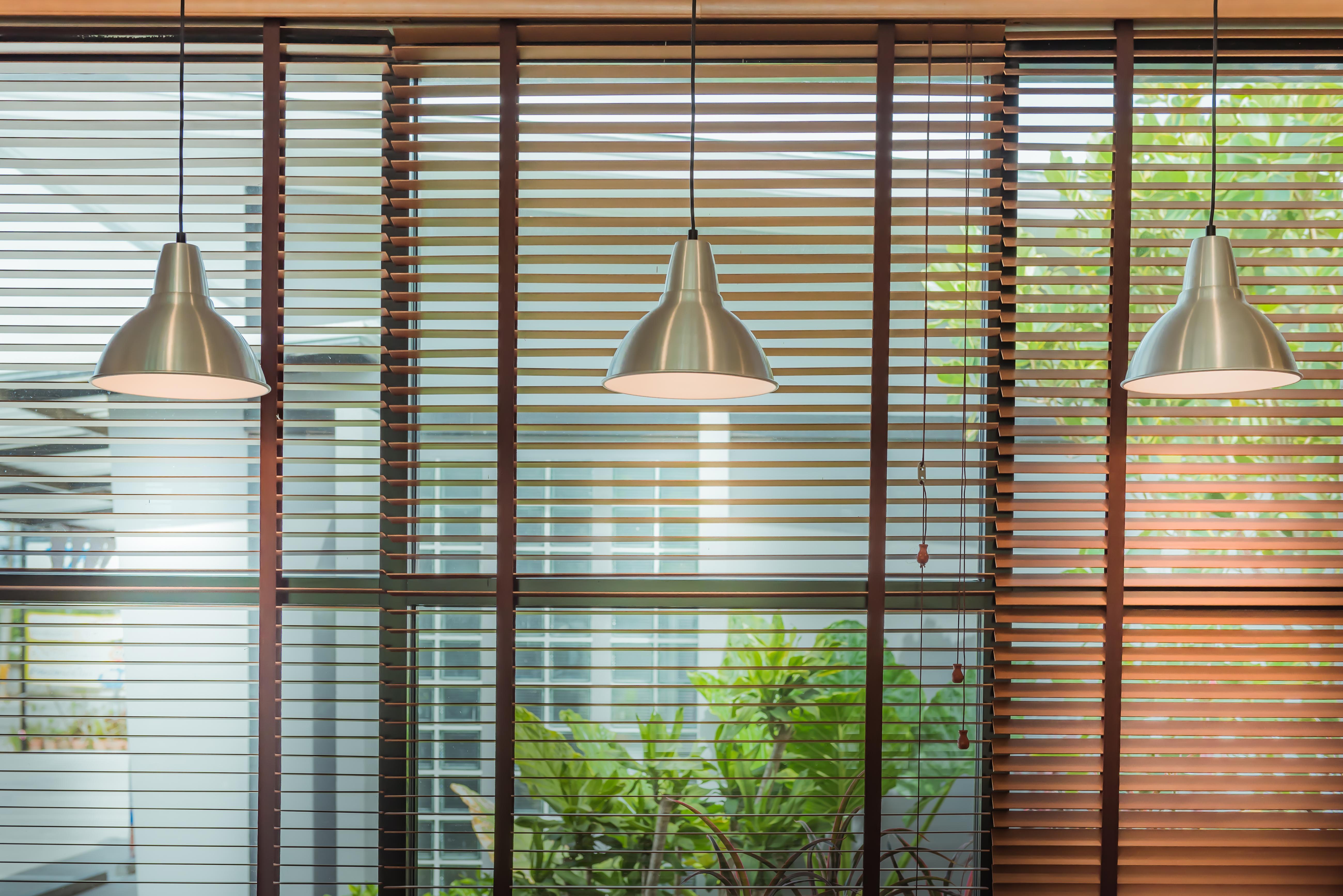 Office Venetian blinds with spotlights.