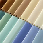 Close up mage of a range of fabric samples in different colours.