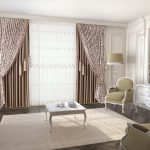 Dramatic curtains and blinds fittings in a glamorous living room. Large rug with a coffee table in the centre and light coming in to the room.