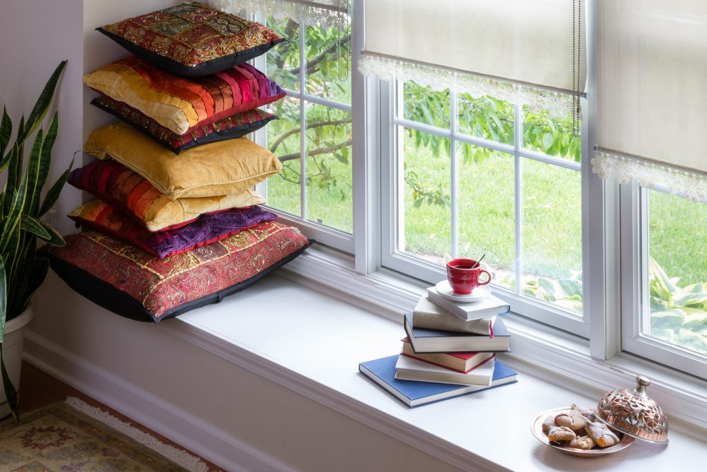 Books, Coffee and Cookies with Piled Square Pillows at the Reading Corner Inside the House for Reading Time Concept with bespoke window blinds