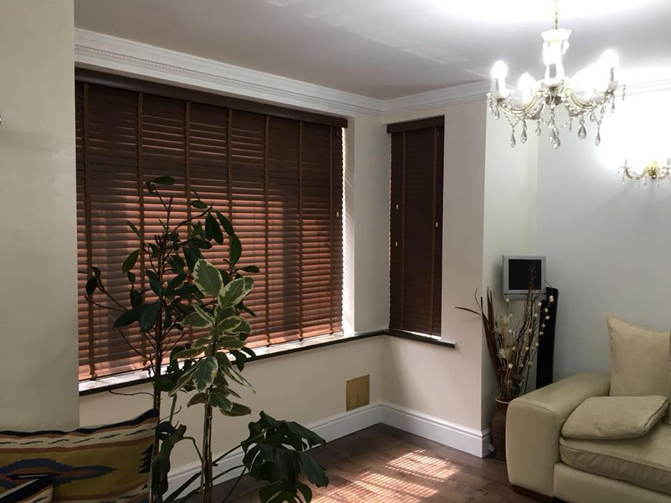 Brown shutter blinds in a living room