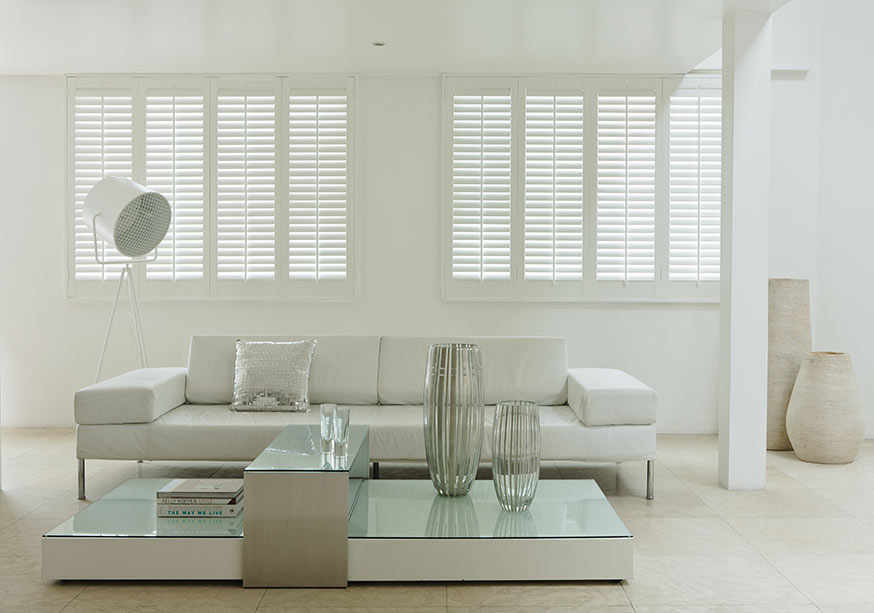 White shutter blinds in a white living room
