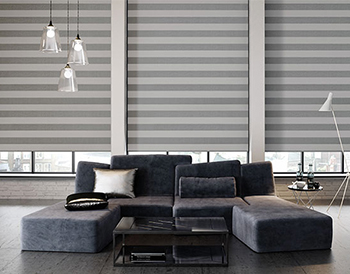 White and grey roman blinds in a grey living room