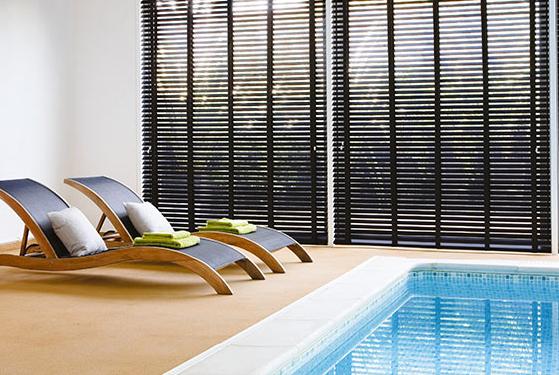 Black venetian blinds for indoor pool