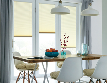 Cream coloured venetian blinds in kitchen