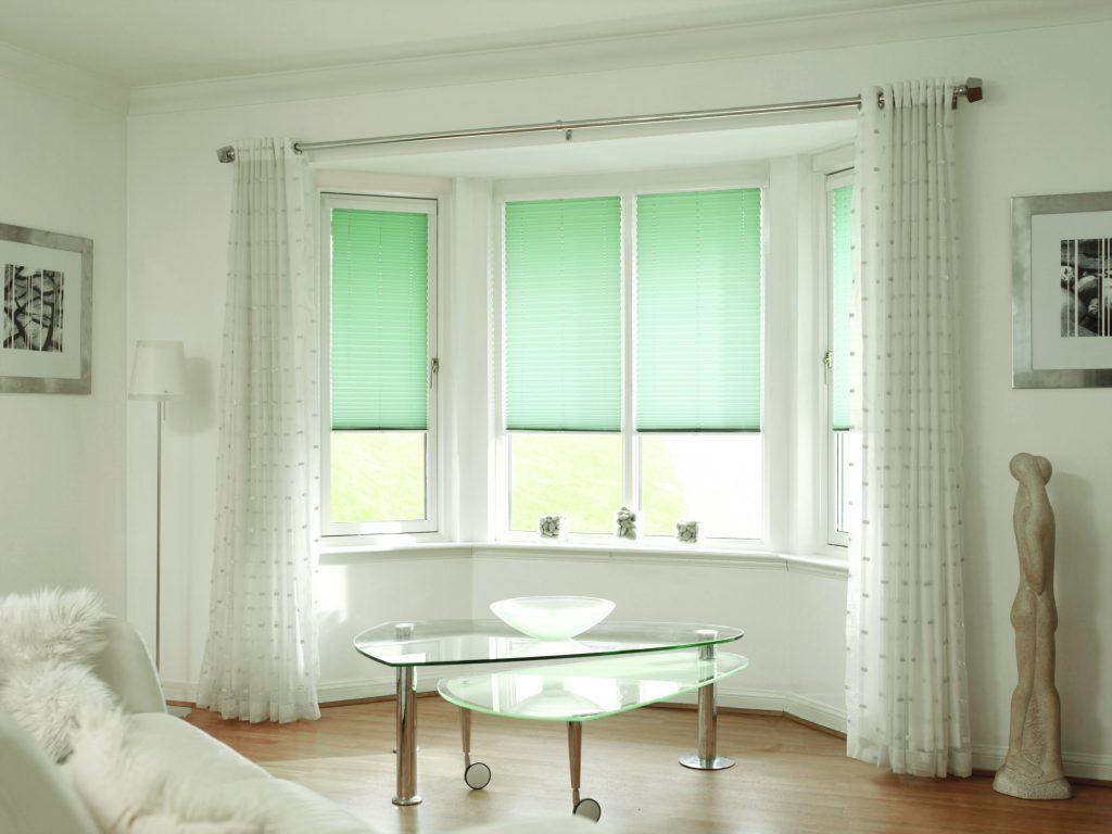 Lime green venetian blinds for bay window in living room