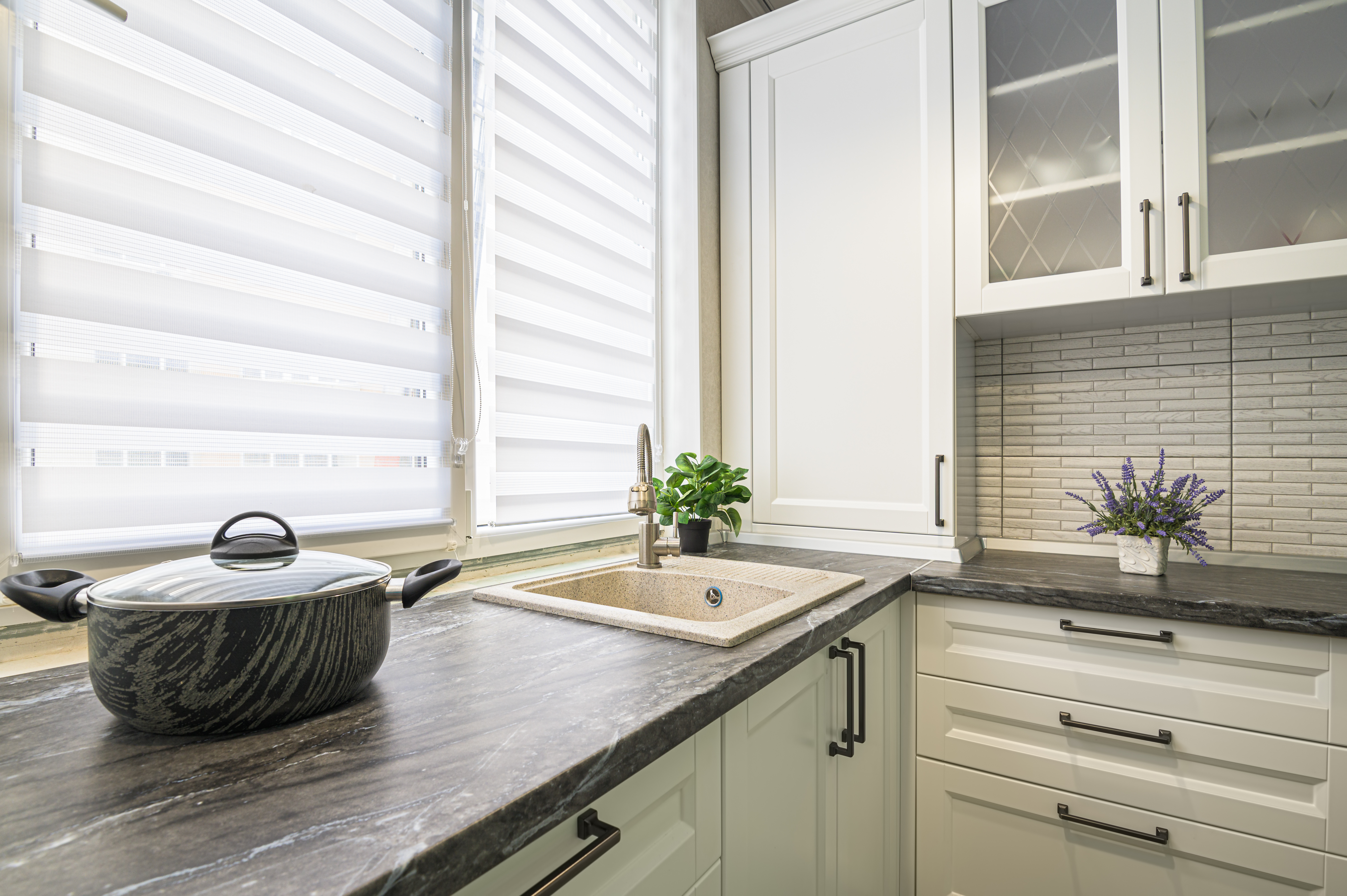 simple well designed modern white kitchen interior with bespoke window blinds
